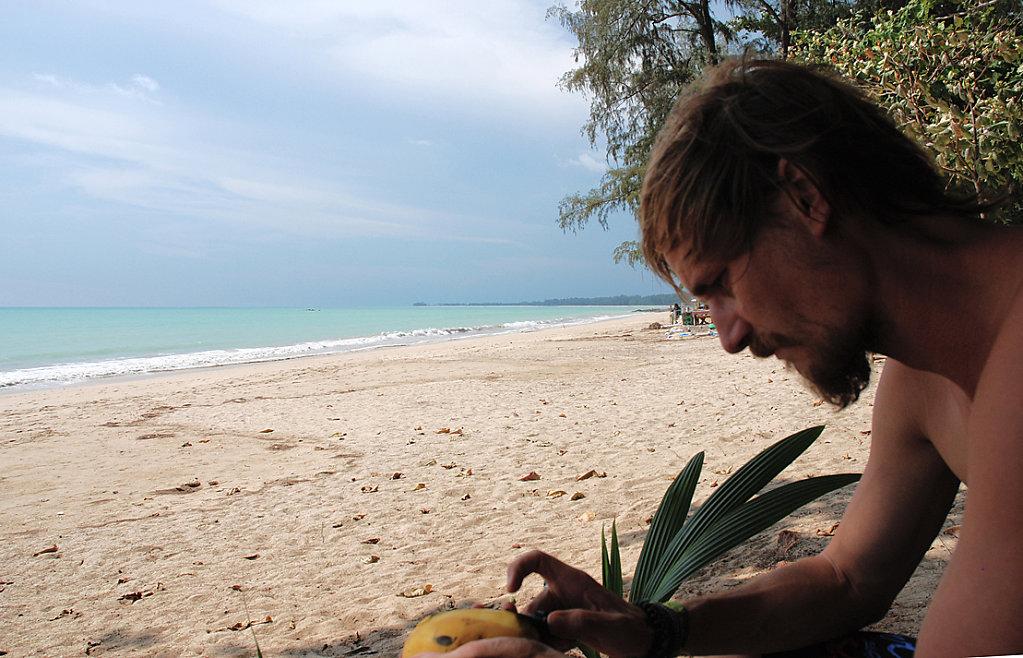 Mark peeling mangos at the beach